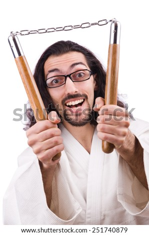Karate man with nunchucks isolated on white - stock photo