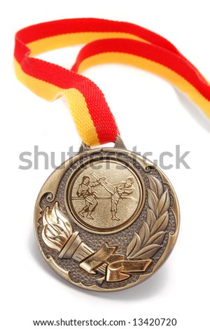 karate medal isolated on white (shallow DOF)