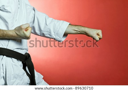 Karate training at gym over red background - stock photo