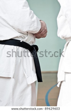 Karate training, brown belt man at gym, gear closeup