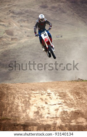 """KARGALY, KAZAKHSTAN - APRIL 10: P.Blinov(10) in action at Motocross competition """"Fabrichny Cup""""- Open Championship of Kazakhstan, on April 10, 2011 in Kargaly, Kazakhstan. - stock photo"""
