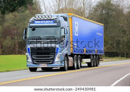 KARJAA, FINLAND - OCTOBER 25, 2014: Blue Volvo FH semi truck on the road. Volvo Trucks wins Europes prestigious Quality Innovation of the Year Award again in 2015, for 2nd consecutive year. - stock photo