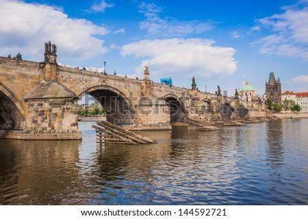 Karlov or charles bridge and river Vltava in Prague in summer - stock photo