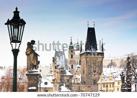 Karlov or charles bridge in Prague in winter - stock photo