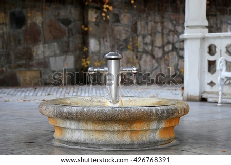KARLOVY VARY (CARLSBAD), CZECH REPUBLIC - NOVEMBER 16, 2014:Termal mineral spring in Karlovy Vary (Carlsbad) -- famous spa city in western Bohemia, very popular tourist destination in Czech Republic  - stock photo