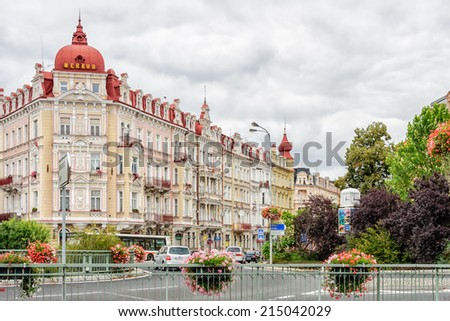 KARLOVY VARY, CZECH REPBULIC - SEPTEMBER 15, 2012: Cars move round traffic circle in historical spa town famous for elaborate, pastel architecture, thermal baths, and health treatment facilities. - stock photo