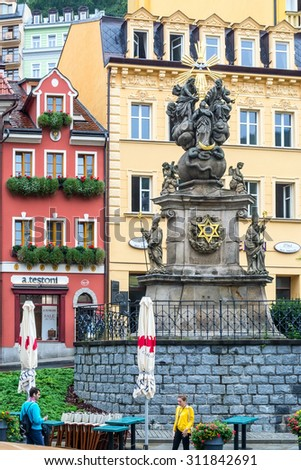 Karlovy Vary, Czech Republic. August 18, 2015: plague column in Karlovy Vary in the summer. It was built in the Baroque style.It is under the protection of UNESCO. - stock photo