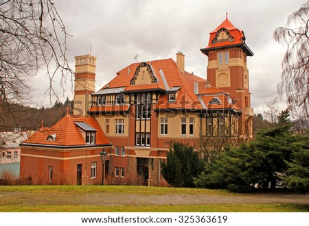 KARLOVY VARY, CZECH REPUBLIC - DECEMBER 28, 2011: Beautiful mansion and garden in winter  at Karlovy Vary, Czech Republic. - stock photo