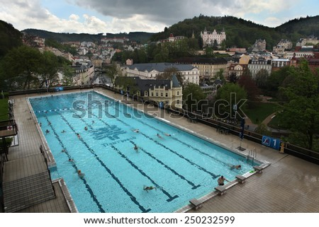 KARLOVY VARY, CZECH REPUBLIC - MAY 8, 2013: Outdoor swimming poll in the Thermal Hotel in Karlovy Vary, Czech Republic.  - stock photo
