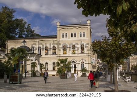 Karlovy Vary,Czech Republic-September 30: Tourists on the Promenade on  September 30, 2015 in Karlovy Vary. Karlovy Vary historically famous for its hot springs (13 main springs, about 300 smaller) - stock photo