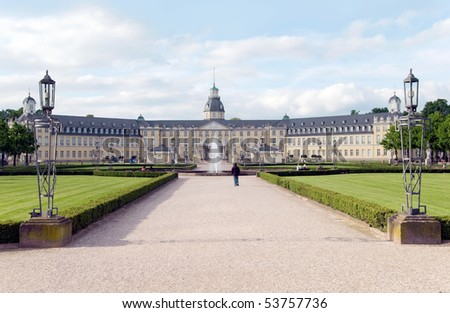 karlsruhe castle with park and fountain - stock photo