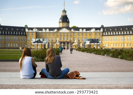 Karlsruhe Schloss, Germany - young women in foreground - stock photo