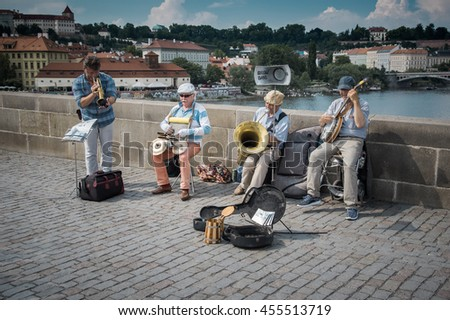 Karluv Most, Prague, Czech Republic - June 5, 2016: Bridge Band Praha - a band of older street musicians playing jazz with their instruments on famous UNESCO protected Charles Bridge, built in 1357 - stock photo