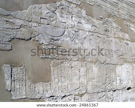 Karnak ancient temple of Egypt. Egyptian Hieroglyphics. Drawing on wall of the ancient temple. To see similar images, please VISIT MY GALLERY. - stock photo