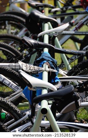 KAROLINKA, CZECH REPUBLIC - AUGUST 08, 2014: Bicycles wait for racers in depo at the Valachia Man triathlon - stock photo