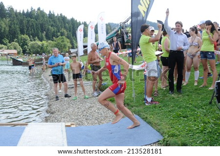 KAROLINKA, CZECH REPUBLIC - AUGUST 08, 2014: Female racer starts the Valachia Man triathlon - stock photo
