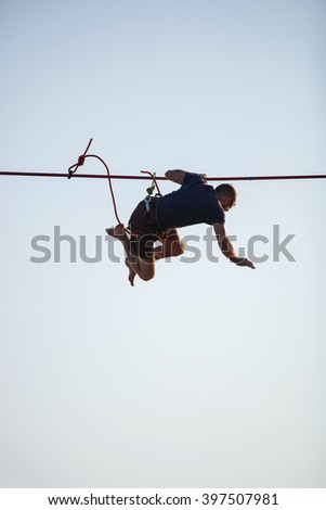 KAROLINO-BUGAZ, UKRAINE - AUGUST 24. Highline walker stumbling while in participating in competition at extreme sports festival on August 24, 2015 in Karolino-Bugaz, Ukraine.