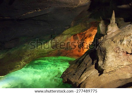 Karst cave with underground river and speleothems. Kizil-Koba (Red cave), Crimea. - stock photo