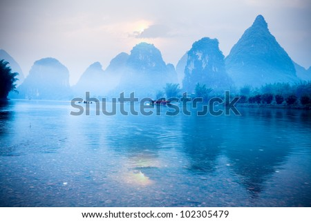 karst hills scenery at sunrise, a famous tourist destination in yangshuo,guilin,China - stock photo