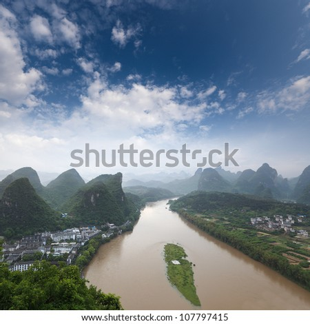 karst landform and the lijiang river against a blue sky in yangshuo,China - stock photo