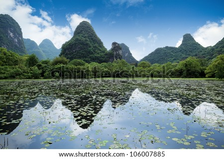 karst mountain landscape and reflection  in yangshuo, guilin, China
