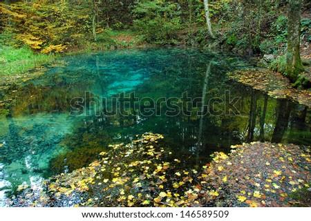 Karst spring at autumn - stock photo