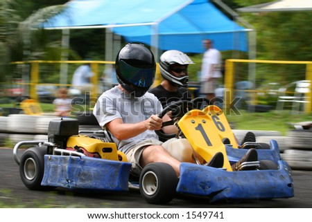 kart overtaking an other - stock photo