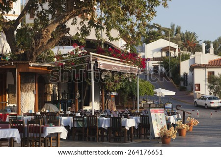 KAS, TURKEY - OCTOBER 15, 2009: Restaurant and Cafe Lola in the village Kas in Turkey. This restaurant is located on the central town sqare Cumhuriyet Meydani and offers a wide range of turkish food.  - stock photo