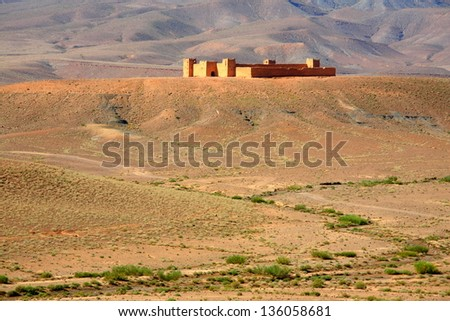 Kasbah in Morocco near Atlas mountains - stock photo