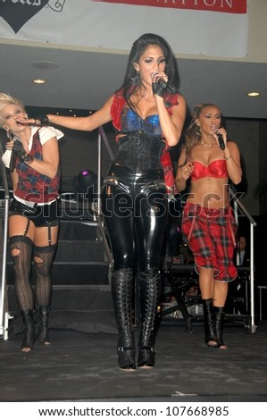 Kasey Campbell with Nicole Scherzinger and Melody Thornton  at an concert to promote the new Pussycat Doll's album 'Doll Domination'. Hollywood and Highland Courtyard, Hollywood, CA. 09-23-08 - stock photo