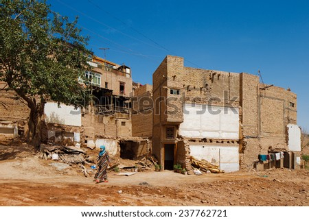 KASHGAR, CHINA - JUL 11: The ancient city of Kashgar, China on Jul 11, 2014 in Kashgar, China. It is an oasis Chinese city on the silk trading route in Xinjiang province, a home to the Uyghur Tribe - stock photo