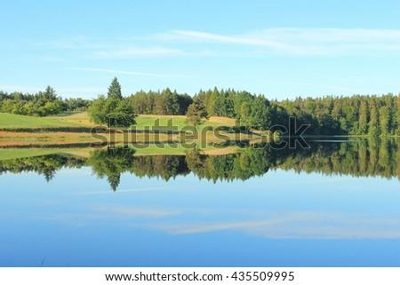 Kashubian lake in the summer. Lake Kamienne is lobelian lake and natural reserve - stock photo
