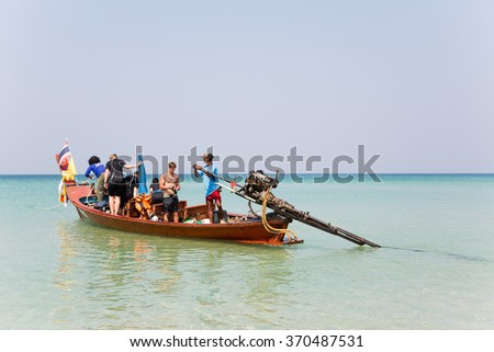 KATA BEACH, THAILAND - CIRCA FEBRUARY, 2015: Tourists on a cruise boat go to sea. Traveling by boat is a popular form of entertainment among tourists. - stock photo
