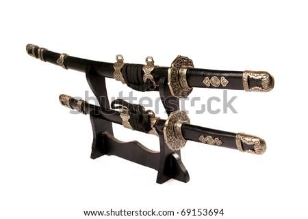 Katana swords on stand isolated on white - stock photo