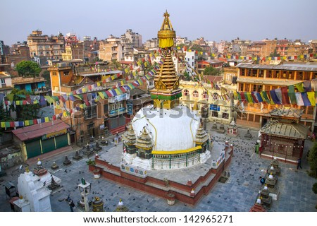 Kathesimbu Stupa with Buddha wisdom eyes and prayer colorful flags in Kathmandu, Nepal - stock photo