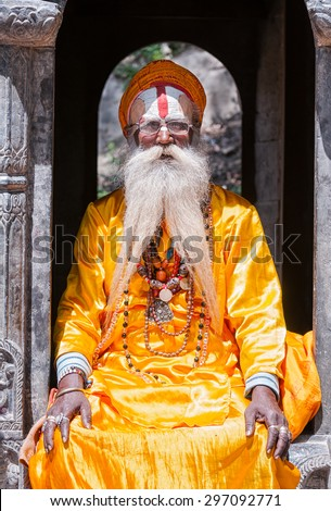 KATHMANDU - APRIL 14: A sadhu at Pashupatinath Temple in Kathmandu, Nepal on April 14, 2012. Sadhus are holy men who have chosen to live an ascetic life and focus on the spiritual practice of Hinduism
