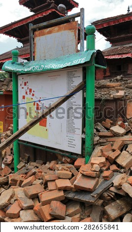 KATHMANDU - APRIL 26: The tourist sign-board after earthquake, near Durbar square, end of April 2015, Kathmandu, Nepal - stock photo