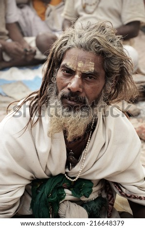 KATHMANDU - MARCH 9: A sadhu at Pashupatinath Temple in Kathmandu, Nepal on MARCH 9, 2012. Sadhus are holy men who have chosen to live an ascetic life and focus on the spiritual practice of Hinduism - stock photo