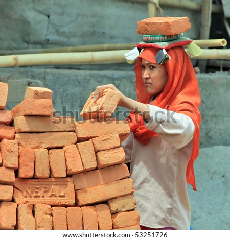 KATHMANDU - MAY 2: Nepalese girl working during the All Nepal strike in early May, 2010 in Kathmandu, Nepal - stock photo