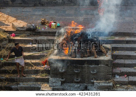 KATHMANDU, NEPAL-APRIL 25: Cremation in Pashupatinath 25, 2016 in Kathmandu, Nepal. The Hindu ritual of cremation in Pashupatinath Temple