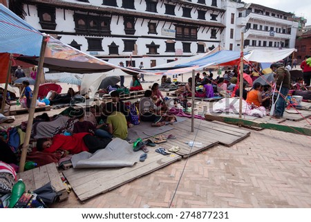 KATHMANDU, NEPAL - APRIL 27, 2015: Frightened people and homeless stay the 3rd day at the open spaces and squares of Kathmandu after 7.8 earthquake - stock photo
