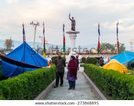 KATHMANDU, NEPAL - APRIL 29, 2015: Makeshift campsite around Pasang Lhamu Sherpa statue in Chuchepati area (north east of Kathmandu) - stock photo