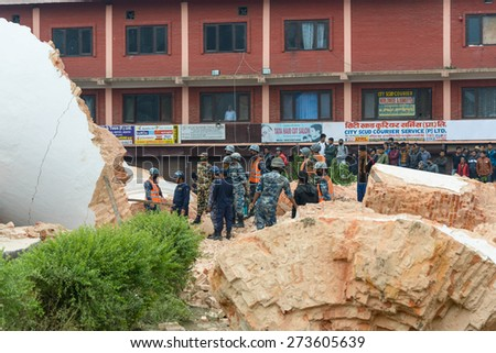 KATHMANDU, NEPAL - APRIL 26, 2015: Nepal Armed Police Force, army and police start rescue efforts at the collapsed Dharhara tower after the major earthquake on 25 April 2015. - stock photo