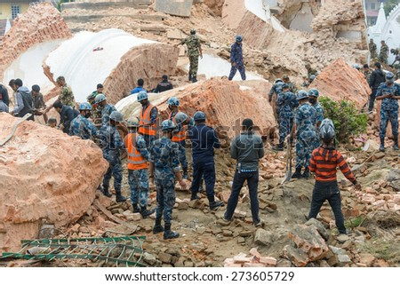 KATHMANDU, NEPAL - APRIL 26, 2015: Nepal Armed Police Force, army, police and civilians start rescue efforts at the collapsed Dharhara tower after the major earthquake on 25 April 2015. - stock photo