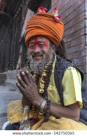 Kathmandu - Nepal, 26 April 2014; Nepalese sadhu man sitting on one side of the ancient temple