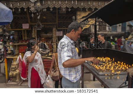 KATHMANDU, NEPAL - CIRCA OCTOBER 2013: Hindu temples usually have their guardians, who in exchange for donations of the faithful care about it. Annapurna Temple circa October 2013 in Kathmandu.