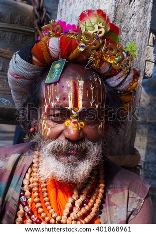 KATHMANDU, NEPAL - FEB 02 : unidentified  Sadhu Holy man with traditional painted face, blessing in Pashupatinath Temple. February 02, 2014, Kathmandu, Nepal.