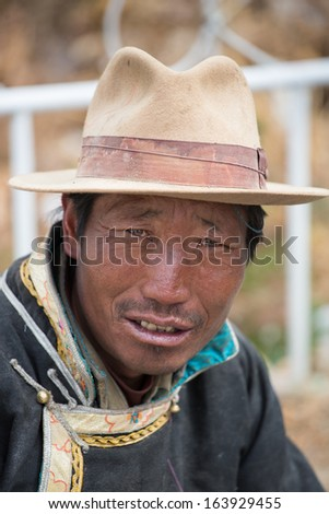 KATHMANDU, NEPAL, JULY 17: Portrait of an unidentified Tibetan man smiling and looking at the camera. There is a wide community of Tibetan people living in Kathmandu. Nepal 2013.