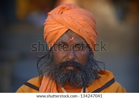 KATHMANDU,NEPAL-MAR CH 15: A Sadhu at Pashupatinath Temple in Kathmandu, Nepal on March 15, 2012. The two primary sectarian divisions in sadhu community are Shaiva sadhus and Vaishnava sadhus. - stock photo