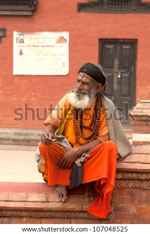 KATHMANDU,NEPAL-MARCH 15: A Sadhu at Pashupatinath Temple in Kathmandu, Nepal on March 15, 2012. The two primary sectarian divisions in sadhu community are Shaiva sadhus and Vaishnava sadhus. - stock photo